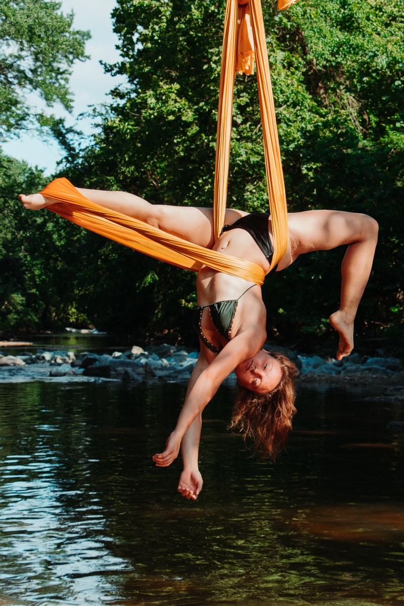 woman lying on hammock during daytime